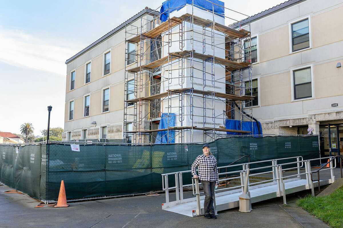 Veteran Cherrie Willingham outside the Veterans Academy in San Francisco. One of two elevators under construction at the facility are visible behind Willingham. The elevators will ease the physical burden and danger of stairs for residents there with mobility concerns.