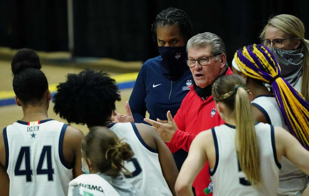 UConn head coach Geno Auriemma talks to his player during a break in the action Tuesday in Storrs, Conn.