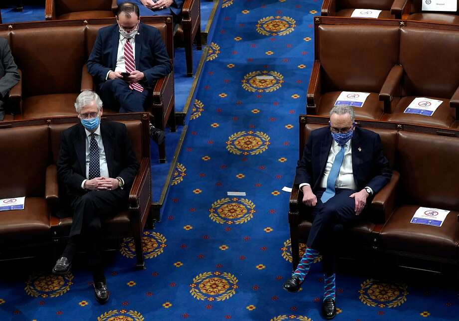 Sens. Mitch McConnell, left, and Chuck Schumer are negotiating ways to share power in a divided Senate. An agreement may lead to little legislation passing. Photo: Drew Angerer / Getty Images