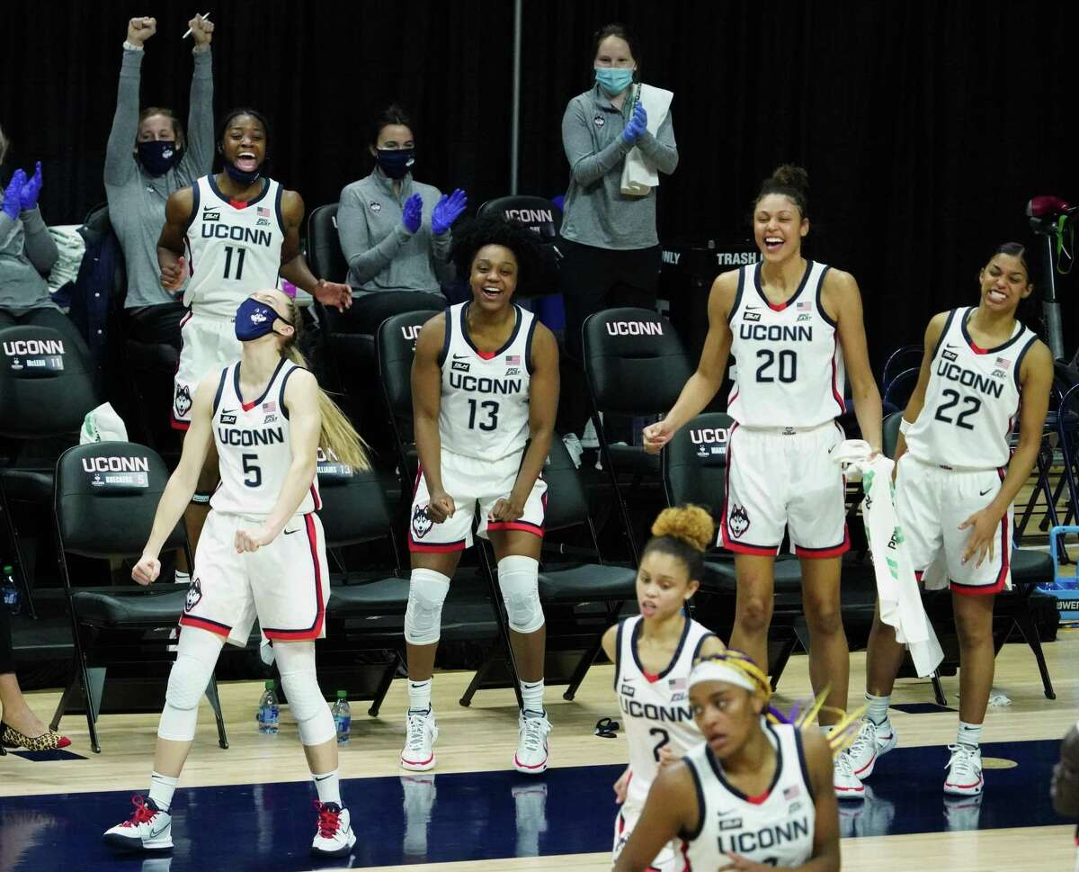 The UConn Huskies bench reacts after a three point basket by Huskies guard Autumn Chassion (2) against the Butler Bulldogs in the second half at Harry A. Gampel Pavilion.