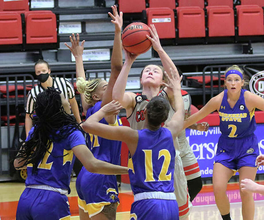 SIUE's Allie Troeckler (middle), shown putting up a shot in a crowd of Morehead State defenders Saturday at First Community Arena in Edwardsville, scored a team-leading 12 points for the Cougars on Tuesday night in an OVC rematch in Morehead, Ky. Photo: Greg Shashack / The Telegraph