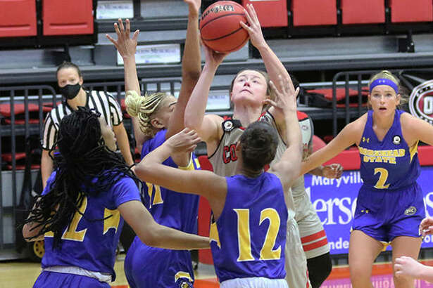 SIUE's Allie Troeckler (middle), shown putting up a shot in a crowd of Morehead State defenders Saturday at First Community Arena in Edwardsville, scored a team-leading 12 points for the Cougars on Tuesday night in an OVC rematch in Morehead, Ky.