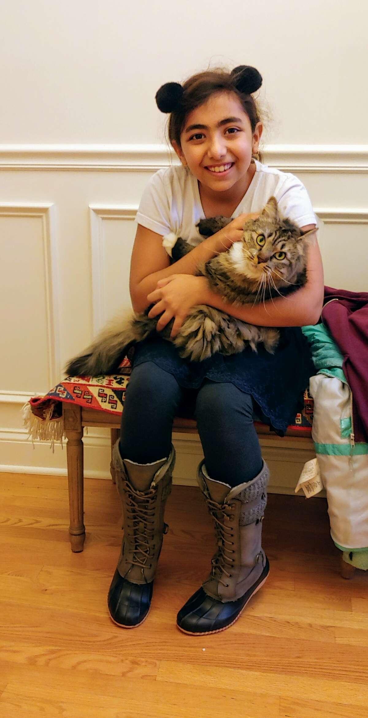 Ranna Payamfar with her beloved cat.