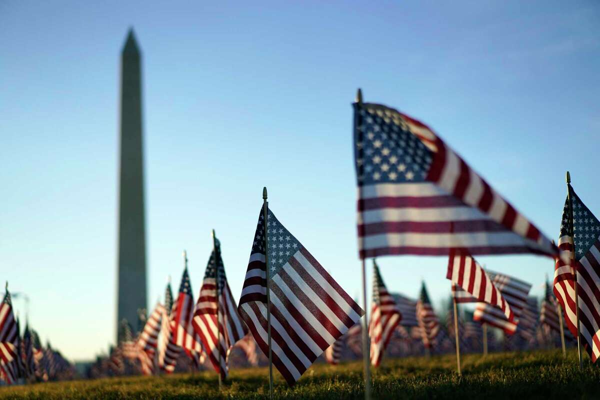 Flags line the National Mall, with the Washington Monument behind them, ahead of the inauguration of President-elect Joe Biden and Vice President-elect Kamala Harris on Tuesday, Jan. 19, 2021, in Washington , D.C. (Kent Nishimura/Los Angeles Times/TNS)
