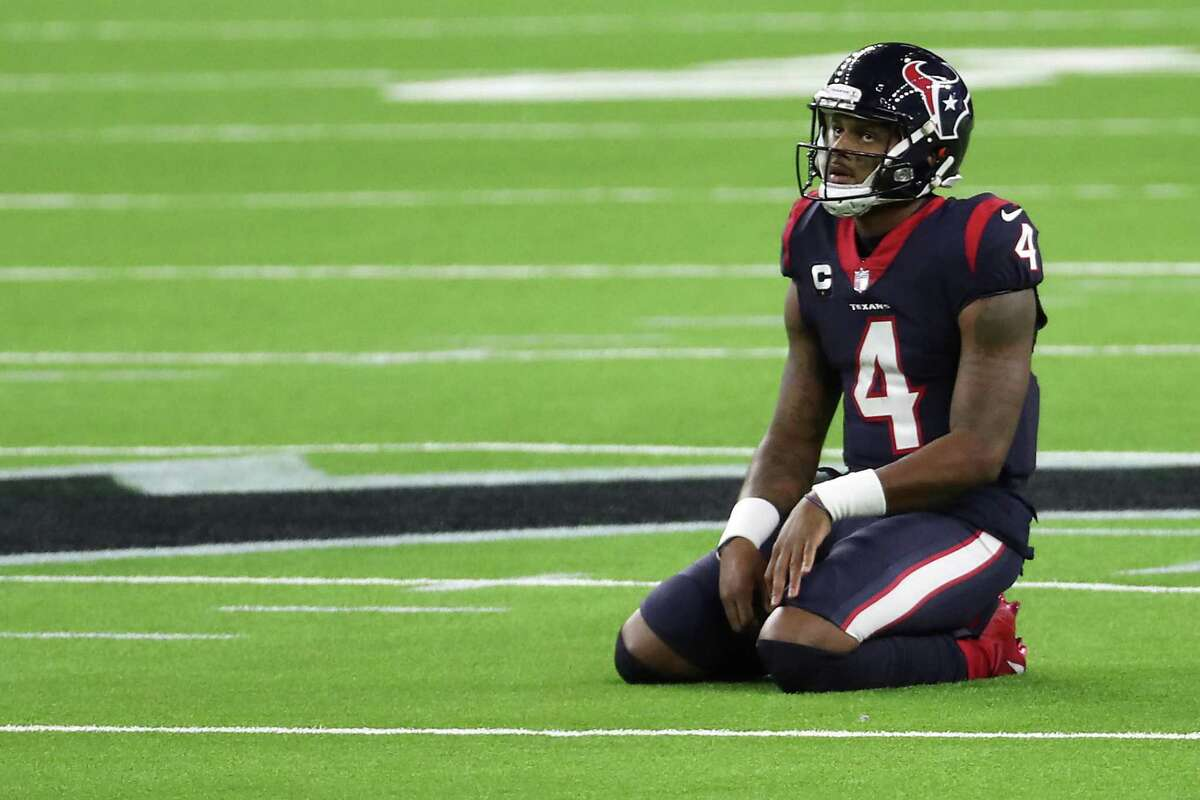 Houston Texans quarterback Deshaun Watson kneels on the field after failing convert on third down near the end of the game against the Tennessee Titans during the fourth quarter of an NFL football game at NRG Stadium on Sunday, Jan. 3, 2021, in Houston.