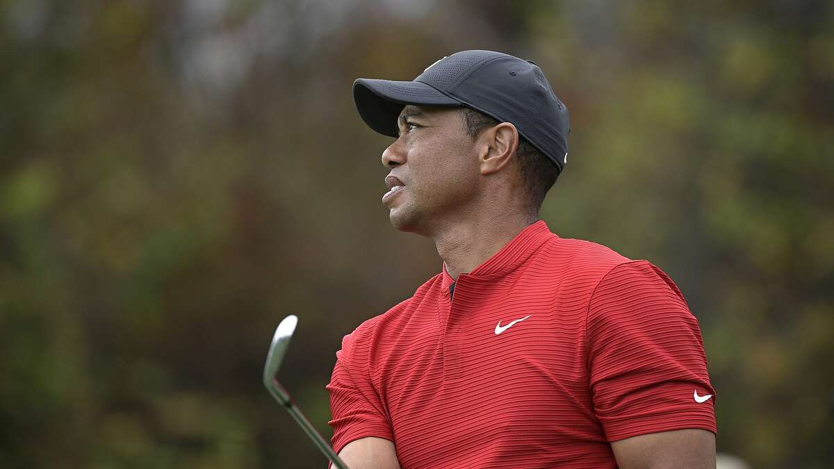 Tiger Woods watches his tee shot on the 12th hole during the final round of the PNC Championship golf tournament, Sunday, Dec. 20, 2020, in Orlando, Fla. (AP Photo/Phelan M. Ebenhack)