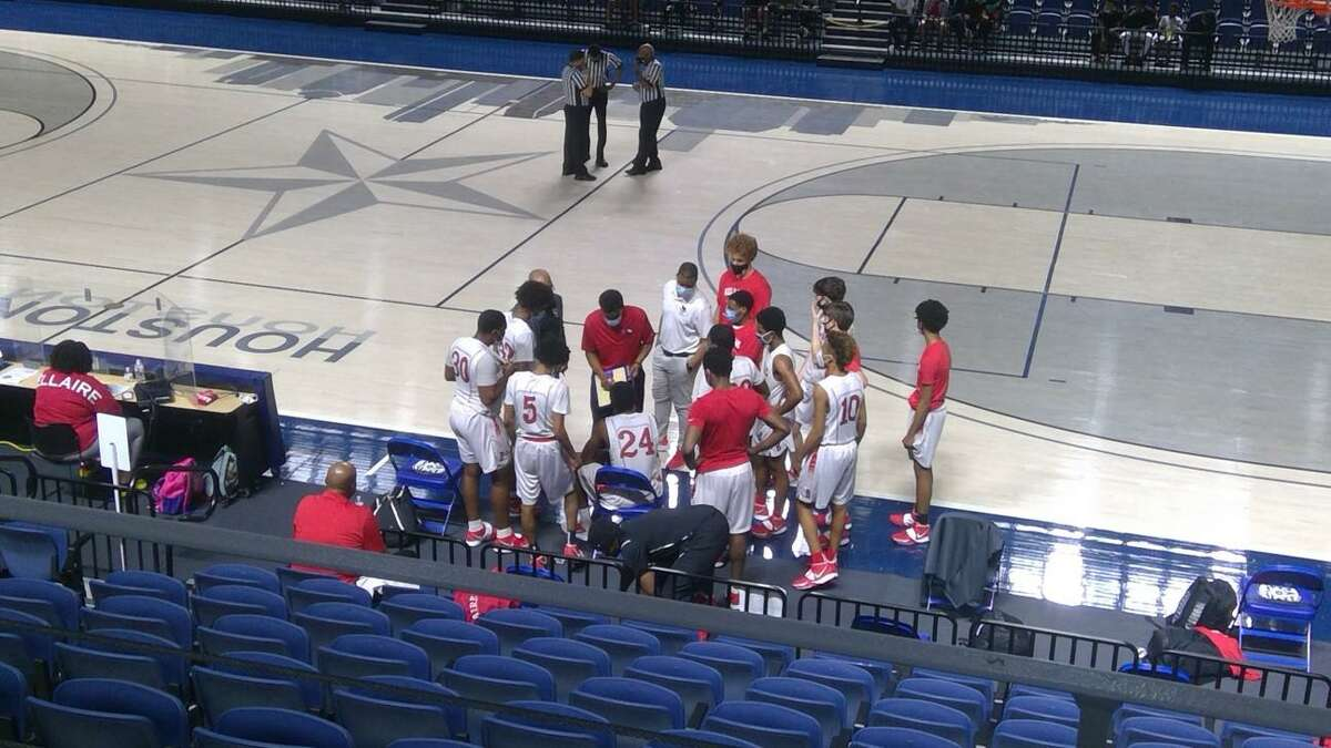 Bellaire coach Bruce Glover talks to his team in between quarters of its District 18-6A game against the Heights Bulldogs at Delmar Fieldhouse on Jan. 19