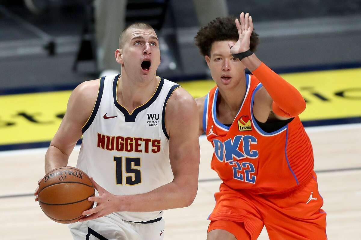 DENVER, COLORADO - JANUARY 19: Nikola Jokic #15 of the Denver Nuggets goes to the basket against Isaiah Roby #22 of the Oklahoma City Thunder in the first quarter at Ball Arena on January 19, 2021 in Denver, Colorado. NOTE TO USER: User expressly acknowledges and agrees that, by downloading and or using this photograph, User is consenting to the terms and conditions of the Getty Images License Agreement (Photo by Matthew Stockman/Getty Images)