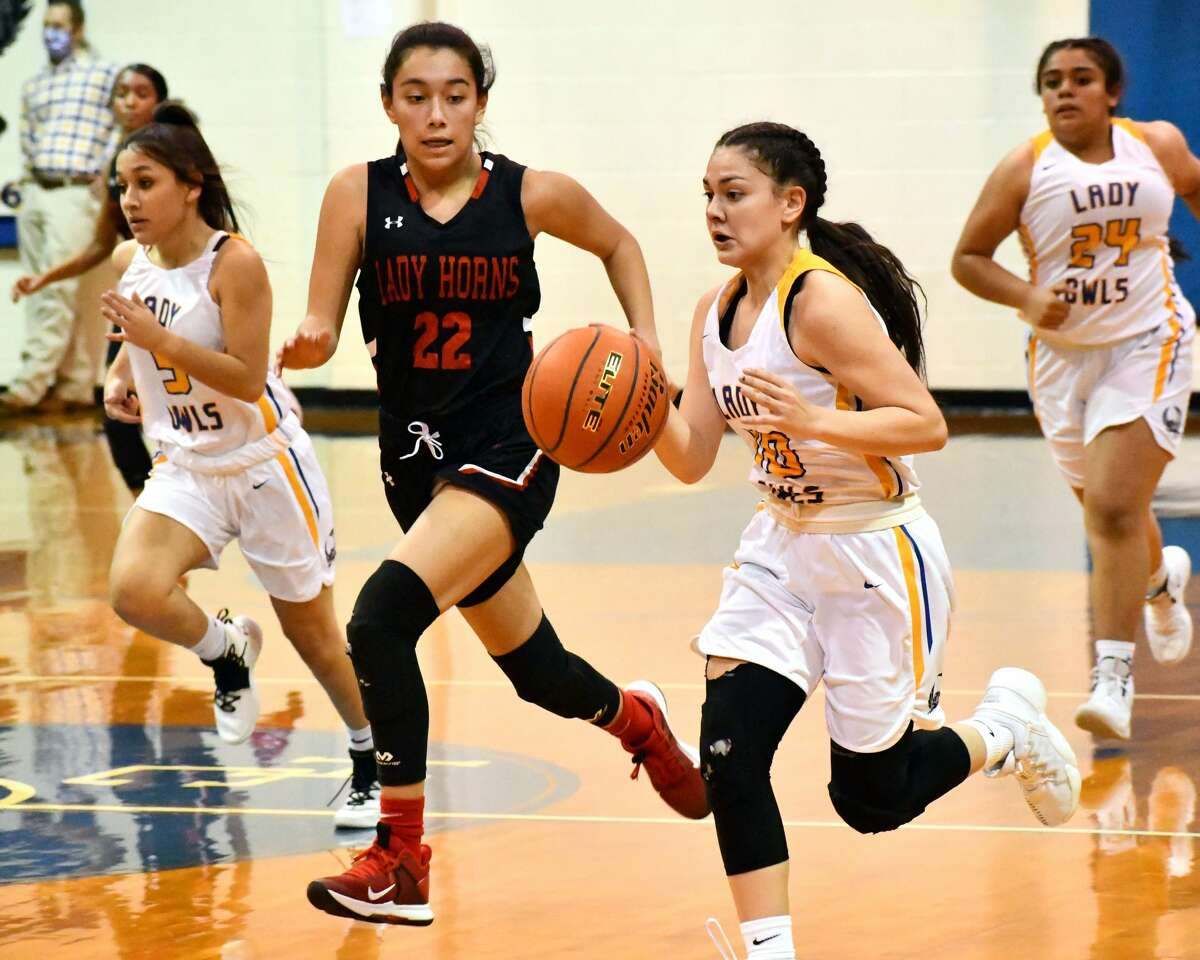 Hale Center's Chloe Bacca dribbles past Lockney defender Senayda Bernal during their District 4-2A girls basketball game on Tuesday at Carr Middle School at Hale Center.