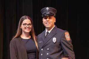EMS officer Jason Cintron with his wife, Shannon, and their daughter, Aria.