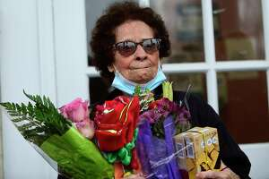 Friends and neighbors hold a 100th birthday celebration for Rose Laviola Friday, Jan. 15, at School House apartments in New Canaan.