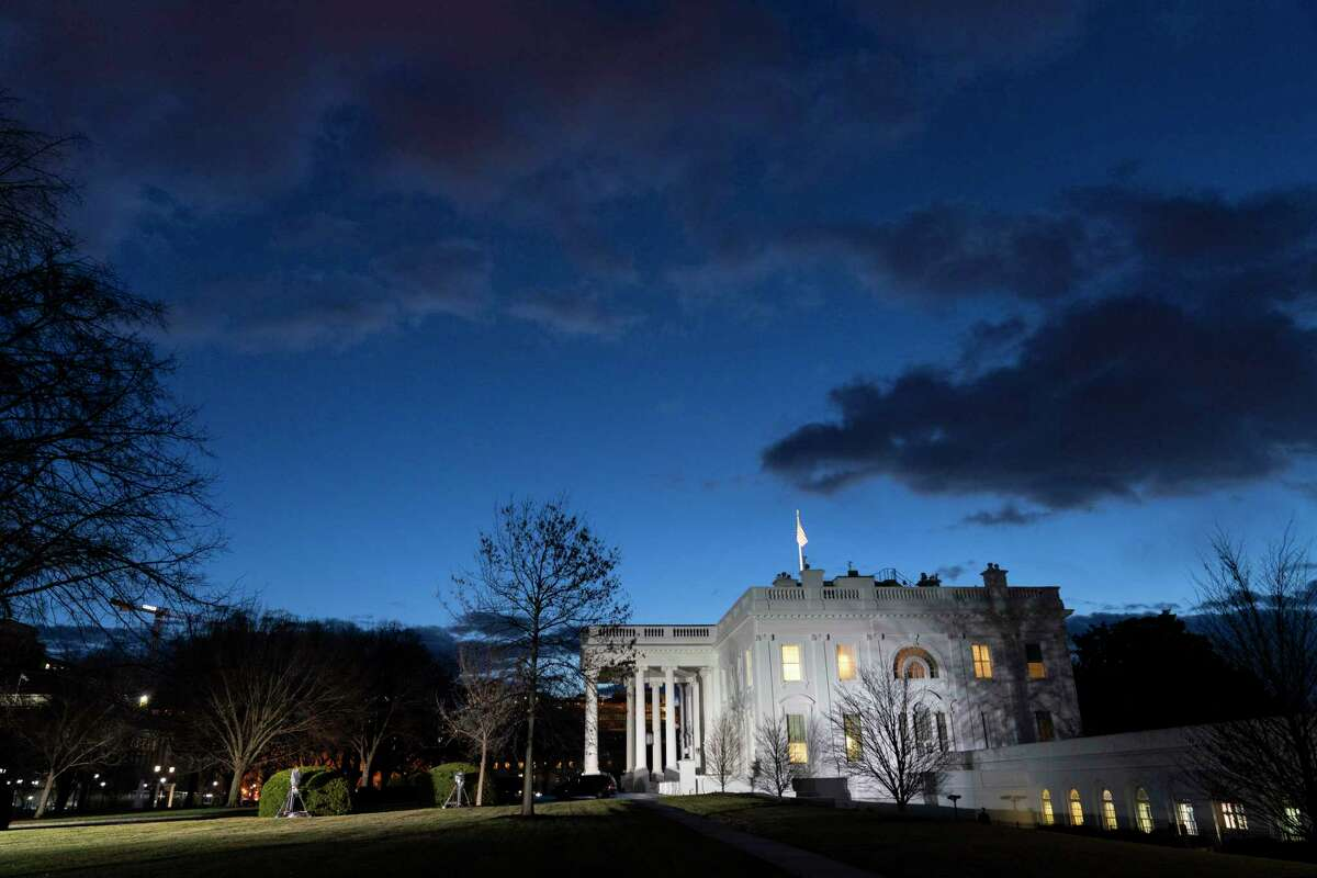 The sun rises behind the White House at dawn, Wednesday, Jan. 20, 2021, in Washington.