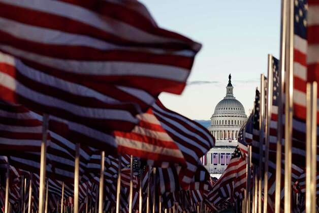 Flags line the National Mall towards the Capitol Building as events get underway for President-elect Joe Biden's inauguration ceremony, Wednesday, Jan. 20, 2021, in Washington. Photo: Julio Cortez, AP / Copyright 2021 The Associated Press. All rights reserved.