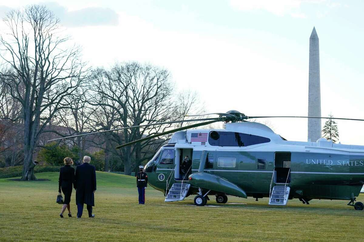 President Donald Trump and first lady Melania Trump walk to board Marine One on the South Lawn of the White House, Wednesday, Jan. 20, 2021, in Washington. Trump is en route to his Mar-a-Lago Florida Resort.