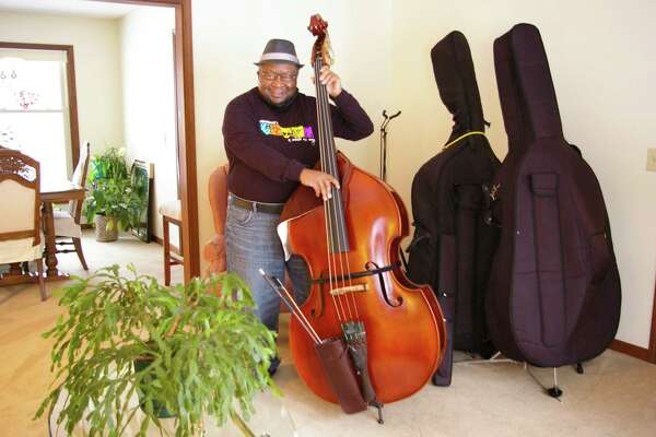 "Roland Wallace of Midland has been involved with music since he was 4. ""My mother was a singer so music saturated my home,"" he said. He plays in several music groups, including a jazz group he started called DJAM. (Photo by Niky House) )"