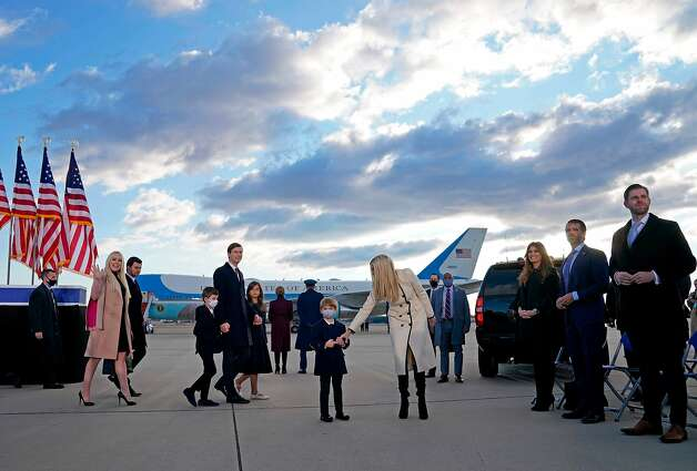 Ivanka Trump (C), husband Jared Kushner (C-L), their children, Eric (R) and Donald Jr. (2nd R), Tiffany Trump (L) and Trump family members stand on the tarmac at Joint Base Andrews in Maryland as they arrive for US President Donald Trump's departure on January 20, 2021. - President Trump travels to his Mar-a-Lago golf club residence in Palm Beach, Florida, and will not attend the inauguration for President-elect Joe Biden. (Photo by ALEX EDELMAN / AFP) (Photo by ALEX EDELMAN/AFP via Getty Images) Photo: Alex Edelman, AFP Via Getty Images