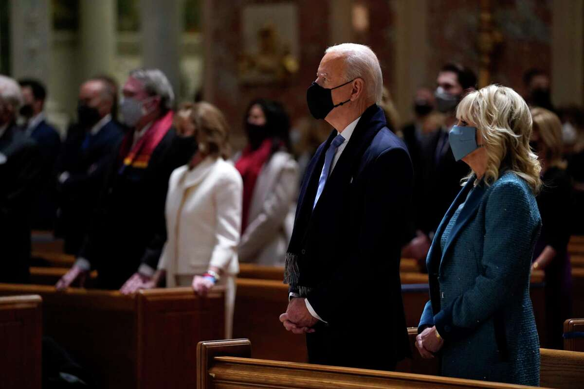 President-elect Joe Biden is joined his wife Jill Biden as they celebrate Mass at the Cathedral of St. Matthew the Apostle during Inauguration Day ceremonies Wednesday, Jan. 20, 2021, in Washington.