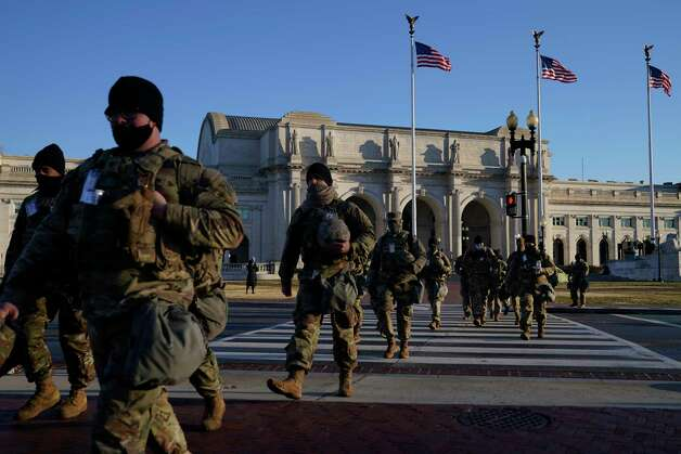 National Guards walk from Union Station to the Capitol Building as events get under way for President-elect Joe Biden's inauguration ceremony, Wednesday, Jan. 20, 2021, in Washington. Photo: John Minchillo, AP / Copyright 2021 The Associated Press. All rights reserved.