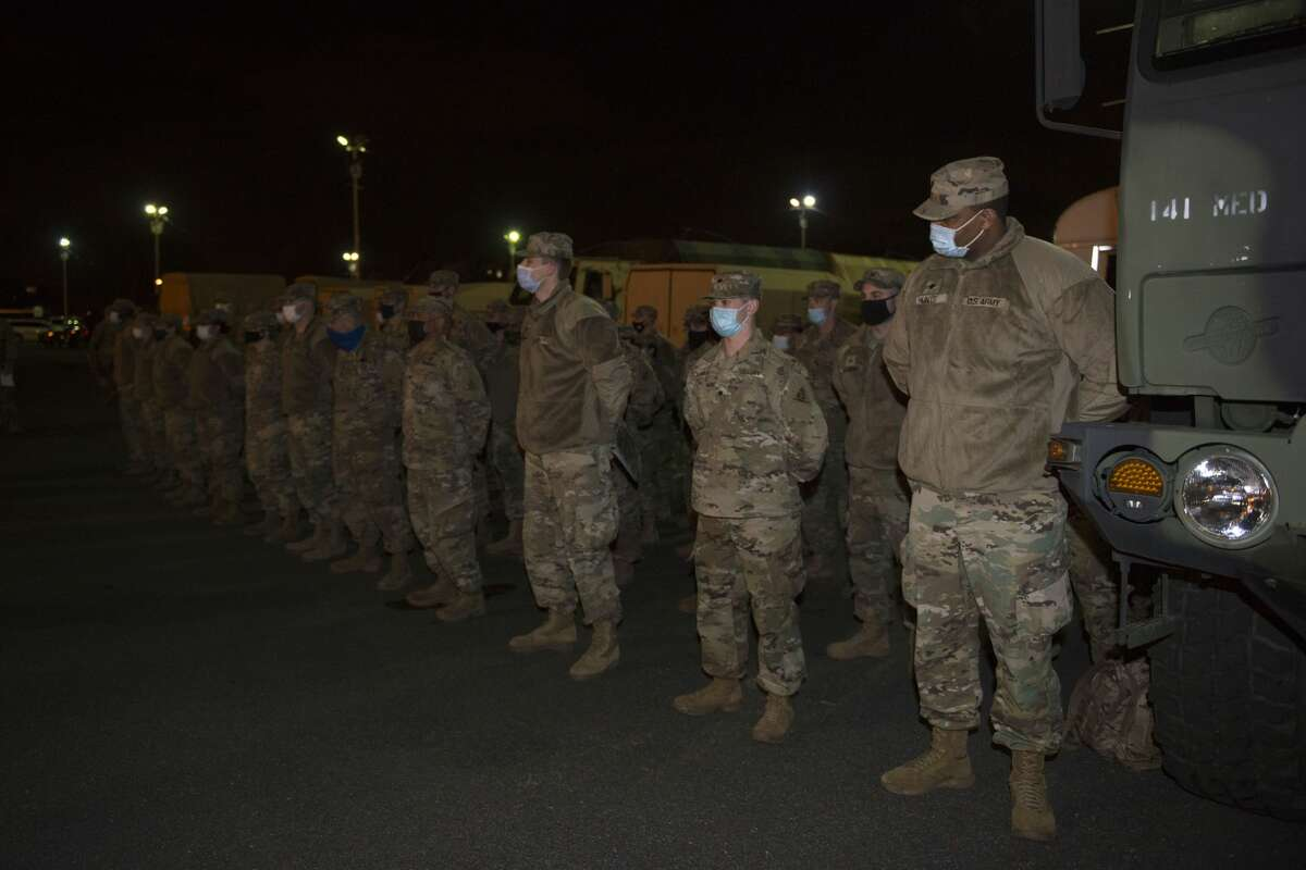 Members of the Connecticut National Guard, 141st Ground Ambulance Company arrive at the D.C. Armory, Jan. 17, 2021, Washington, D.C. At least 25,000 National Guard men and women have been authorized to conduct security, communication and logistical missions in support of federal and District authorities leading up and through the 59th Presidential Inauguration.