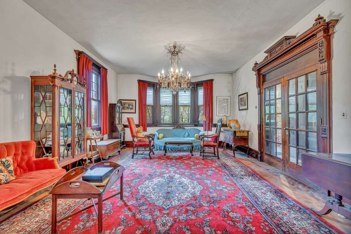 Family room with ornate French doors at 5 St. Ronan Terrace, New Haven. Although it was originally built as a home, this antique structure served as the private Gateway School for Girls for several decades, before once again becoming a residence. Perhaps that's why the house features eight bedrooms, which may have served as dormitories or perhaps classrooms.