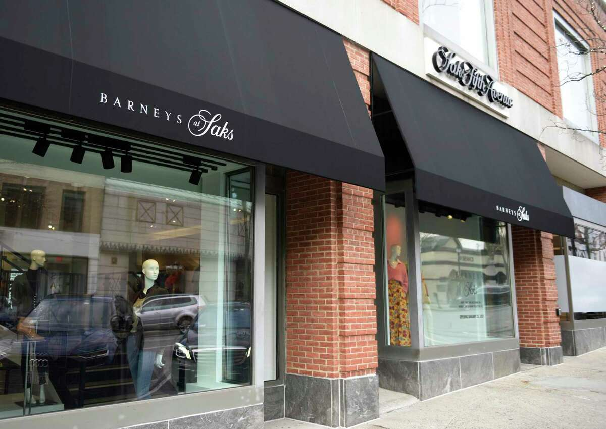 A sign for the new Barneys at Saks is displayed at the location of the former store known as Saks Fifth Avenue The Collective in Greenwich, Conn. Tuesday, Jan. 19, 2021. According to the Saks management, the 14,000-square-foot store at 200 Greenwich Ave. will feature men's shoes and accessories on the first floor, the first time Saks has offered men's merchandise in the Greenwich market. The second floor will sell women's clothing. Barneys New York was a longtime fashion retailer that fell into bankruptcy in 2019. But the brand name was later acquired by Authentic Brands for licensing deals with other companies. A new version of Barneys New York has already opened on the fifth floor of the Manhattan location of Saks.
