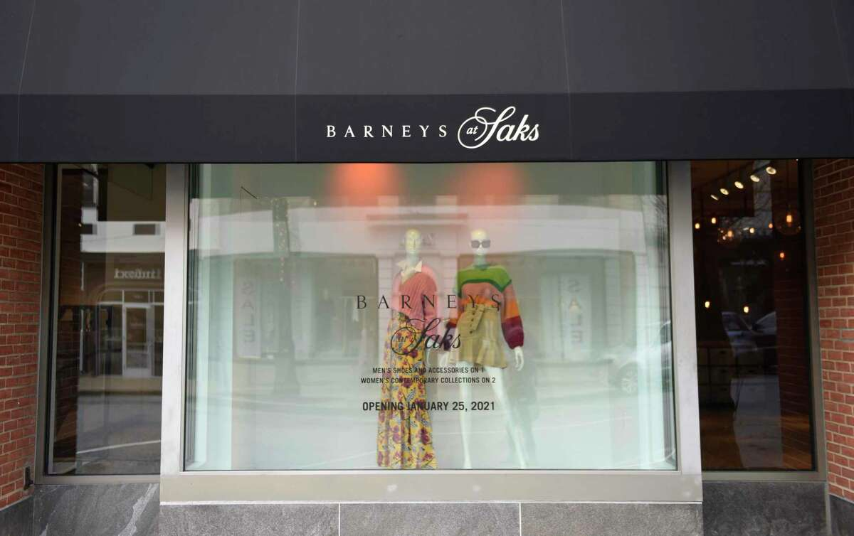 A sign for the new Barneys at Saks is displayed at the location of the former store known as Saks Fifth Avenue The Collective in Greenwich, Conn. Tuesday, Jan. 19, 2021.