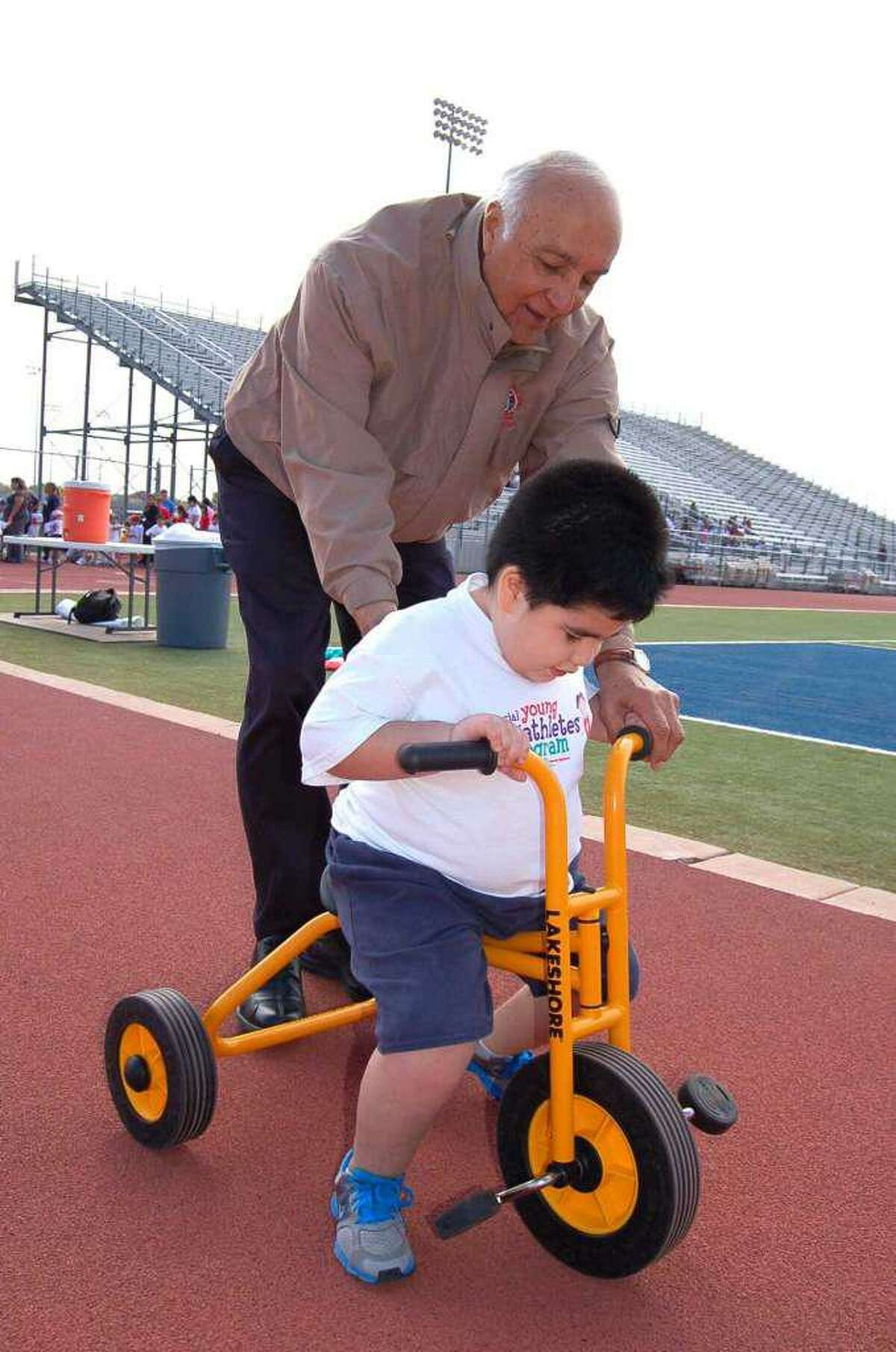 Longtime UISD Superintendent Roberto Santos works with a child during a previous event at the SAC. Santos is set to retire after 38 years with the district next June.