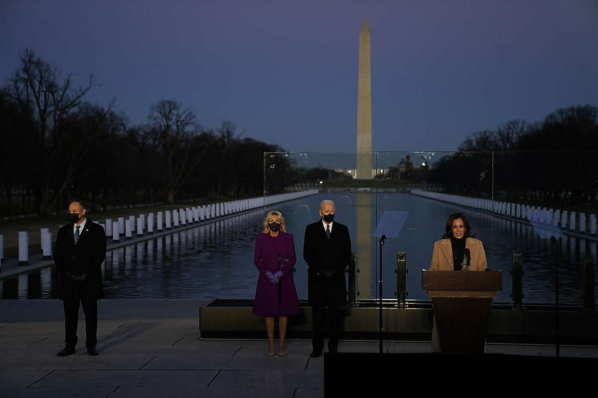 From left: Doug Emhoff, Jill Biden and President-elect Joe Biden listen as Vice President-elect Kamala Harris speaks during a COVID-19 memorial event at the Lincoln Monument Reflecting Pool in Washington on Tuesday evening, Jan. 19, 2021. (Doug Mills/The New York Times)