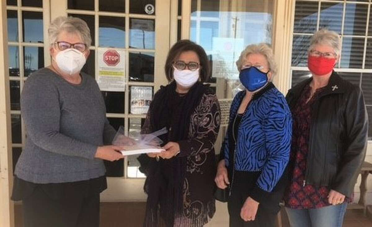 (L-R): Shown accepting the hand-written massages for the residents at the Prairie House Living Center is Georgiana Roller, Administrator, Irma Shackelford, Project Director for the AmeriCorps Senior program and volunteers Evelyn Ball and Jane Ebeling.