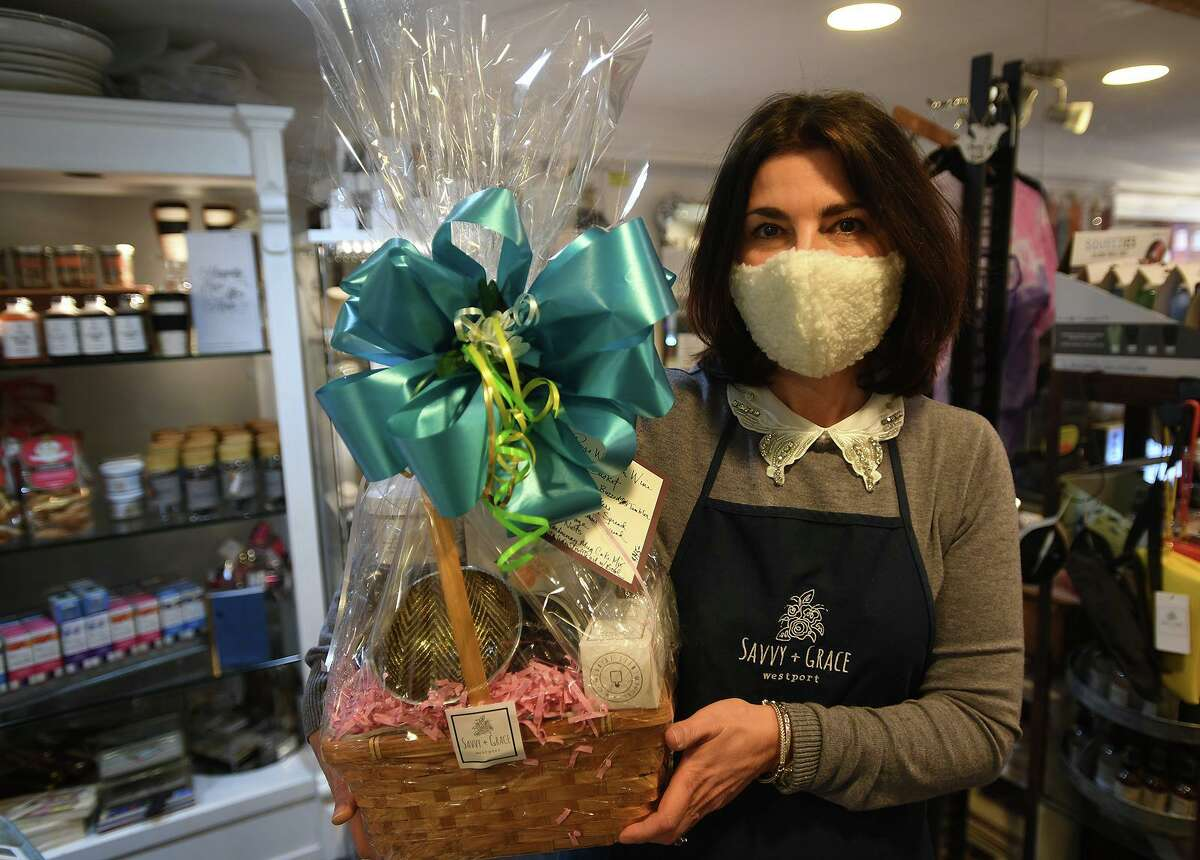 Annette Norton began creating her signature gift baskets, now an important part of her business, in response to the pandemic at her Savvy+Grace boutique in Westport, Conn. on Thursday, January 14, 2021.