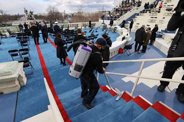 WASHINGTON, DC - JANUARY 20: The stairs are vacuumed prior to the inauguration of U.S. President-elect Joe Biden on the West Front of the U.S. Capitol on January 20, 2021 in Washington, DC. During today's inauguration ceremony Joe Biden becomes the 46th president of the United States. (Photo by Jonathan Ernst-Pool/Getty Images) Photo: Pool/Getty Images / 2021 Getty Images