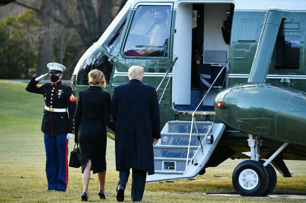 US President Donald Trump and First Lady Melania make their way to board Marine One before departing from the South Lawn of the White House in Washington, DC on January 20, 2021. - President Trump travels his Mar-a-Lago golf club residence in Palm Beach, Florida, and will not attend the inauguration for President-elect Joe Biden. (Photo by MANDEL NGAN / AFP) (Photo by MANDEL NGAN/AFP via Getty Images) Photo: MANDEL NGAN/AFP Via Getty Images