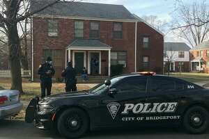 Police at the scene after a homicide in Bridgeport, Conn., on Jan. 20, 2021. Capt. Kevin Gilleran said 34-year-old Angel Valle died after he was allegedly stabbed by his brother, 25-year-old Julian Daivon Valle around 2 a.m. Wednesday.