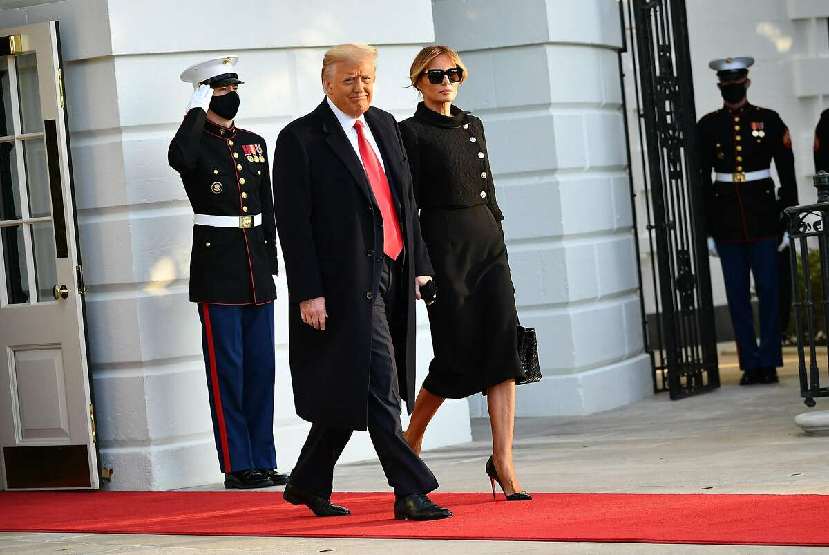 President Donald Trump and First Lady Melania make their way to board Marine One before departing from the South Lawn of the White House in Washington, DC.