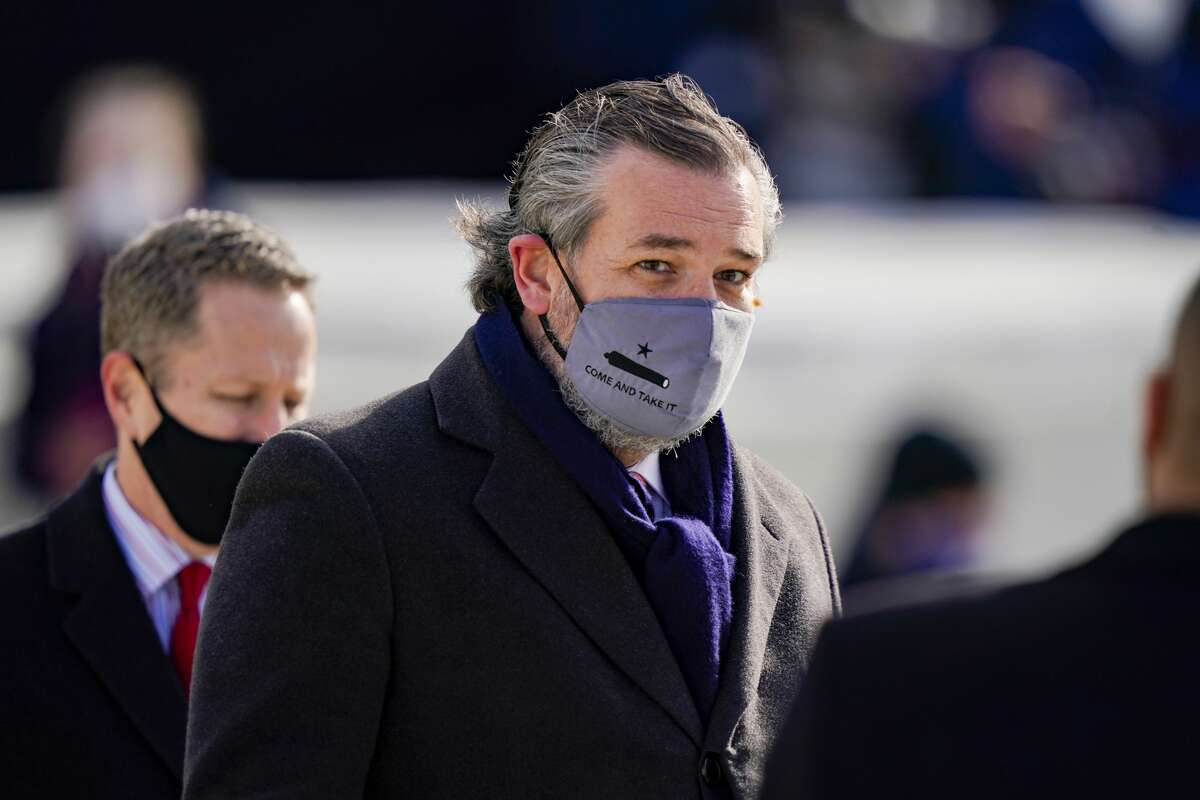 """Sen. Ted Cruz, wearing a """"Come and Take It""""face mask, arrives at President Joe Biden's inauguration in a January file photo."""