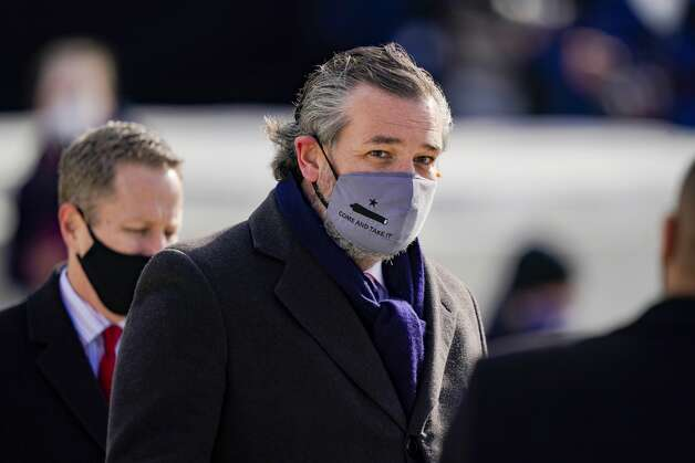 """WASHINGTON, DC - JANUARY 20: Sen. Ted Cruz (C) (R-TX), wearing a face mask that reads """"Come and Take It"""", arrives to the inauguration of U.S. President-elect Joe Biden on the West Front of the U.S. Capitol on January 20, 2021 in Washington, DC. During today's inauguration ceremony Joe Biden becomes the 46th president of the United States. (Photo by Drew Angerer/Getty Images) Photo: Drew Angerer/Getty Images / 2021 Getty Images"""