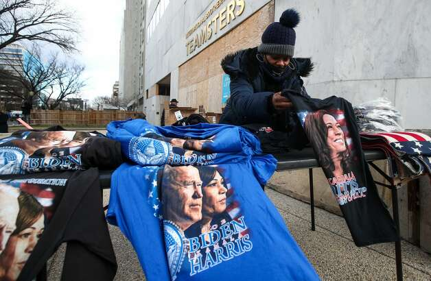 WASHINGTON, D.C., UNITED STATES - JANUARY 20, 2021: A woman sells clothing with the likenesses of Joe Biden and Kamala Harris in the vicinity of the Capitol Building. The inauguration ceremony for US President-elect Joe Biden and US Vice President-elect Kamala Harris takes place in Washington, D.C., on January 20, at noon local time (8pm Moscow time). Yegor Aleyev/TASS (Photo by Yegor Aleyev\TASS via Getty Images) Photo: Yegor Aleyev/Yegor Aleyev/TASS