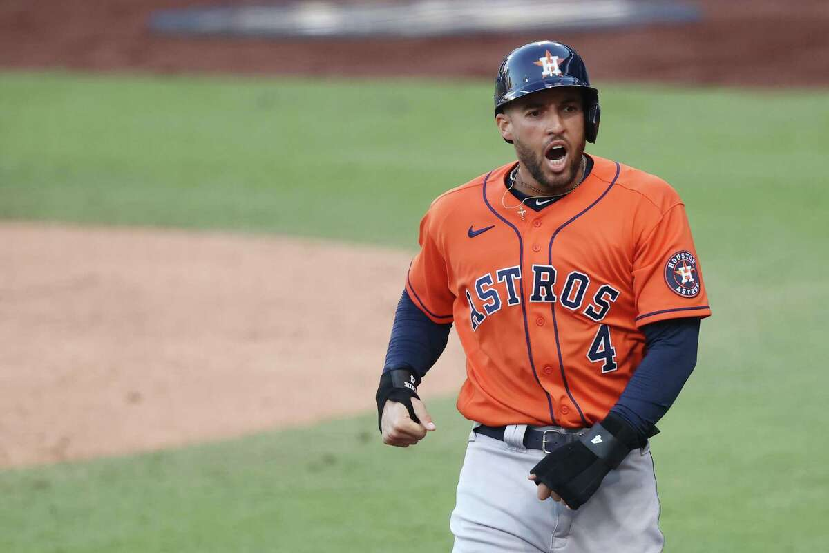 In this file photo, George Springer (4) of the Houston Astros celebrates scoring on a Jose Altuve (27) RBI double during the fifth inning against the Tampa Bay Rays in Game Six of the American League Championship Series at PETCO Park on October 16, 2020 in San Diego, California. (Ezra Shaw/Getty Images/TNS)