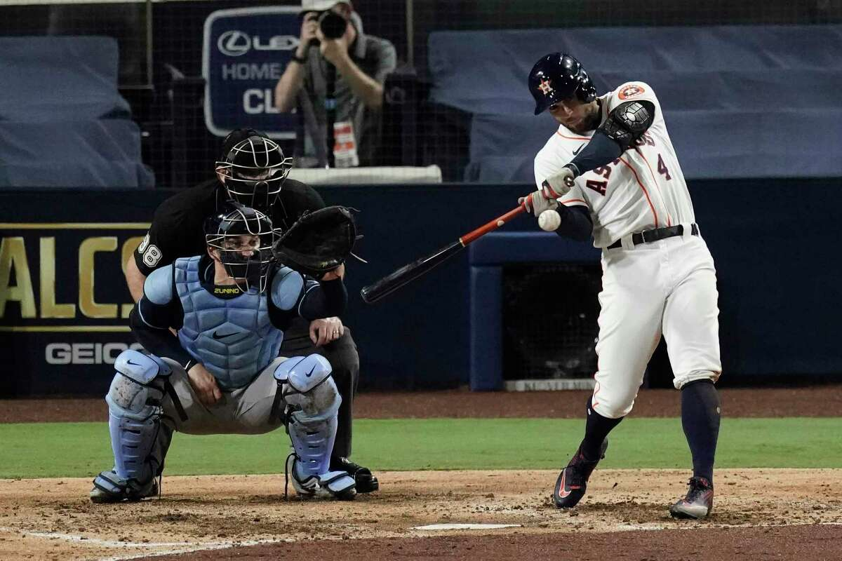 Houston Astros George Springer hits a two run home run against the Tampa Bay Rays during the fifth inning in Game 4 of a baseball American League Championship Series, Wednesday, Oct. 14, 2020, in San Diego.(AP Photo/Jae C. Hong)