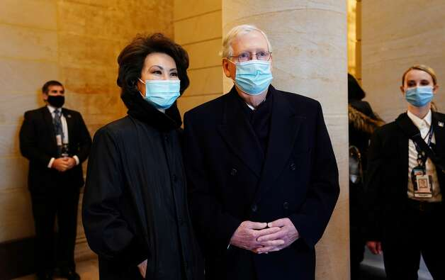 Senate Majority Leader Mitch McConnell (R) and former Secretary of Transportation Elaine Chao (L) arrives for the inauguration of Joe Biden as the 46th US President on January 20, 2021, at the US Capitol in Washington, DC. (Photo by JIM LO SCALZO / POOL / AFP) (Photo by JIM LO SCALZO/POOL/AFP via Getty Images) Photo: JIM LO SCALZO/POOL/AFP Via Getty Images