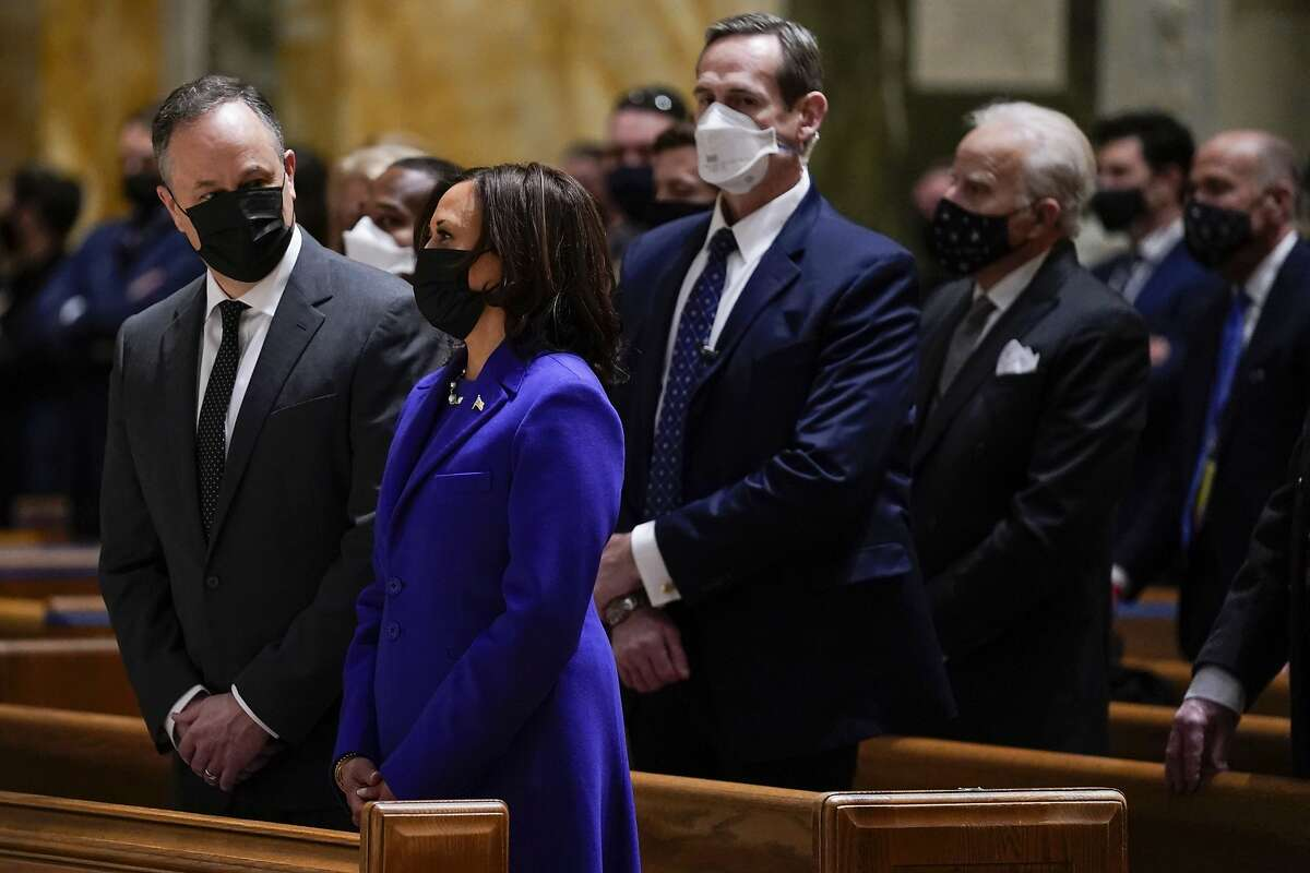 Vice President Kamala Harris and her husband, Doug Emhoff, attend Mass at the Cathedral of St. Matthew the Apostle during Inauguration Day ceremonies in Washington, D.C.