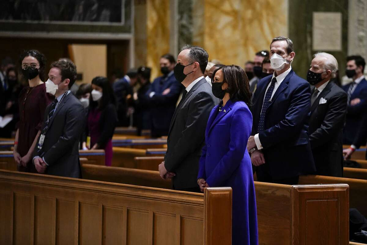 Vice President Kamala Harris and her husband, Doug Emhoff, attend Mass at the Cathedral of St. Matthew the Apostle on Inauguration Day in Washington.