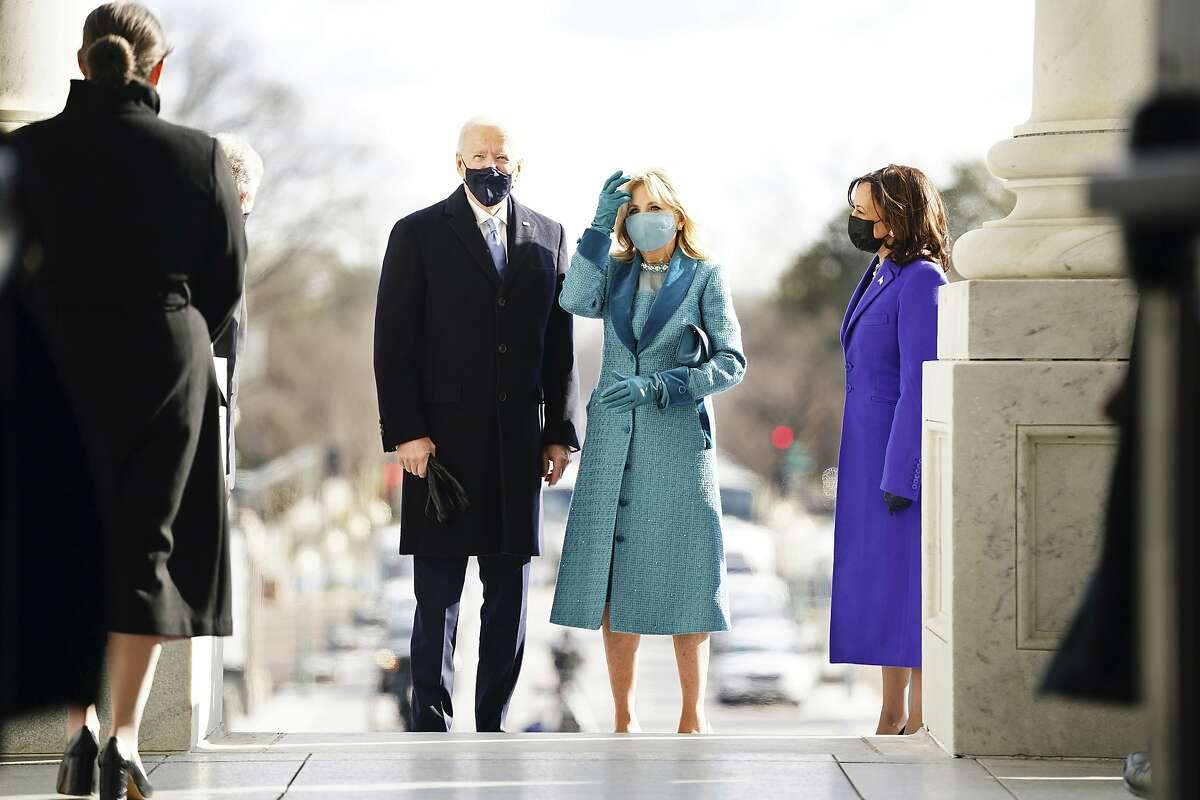 President-elect Joe Biden and his wife Jill Biden arrive at the East Front of the U.S. Capitol ahead of Biden's inauguration, Wednesday, Jan. 20, 2021, at the U.S. Capitol in Washington.