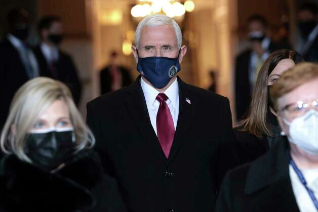 Vice President Mike Pence arrives at the inauguration of U.S. President-elect Joe Biden on the West Front of the U.S. Capitol on Wednesday, Jan. 20, 2021 in Washington (Win McNamee/Pool Photo via AP) Photo: Win McNamee, AP / 2021 Getty Images