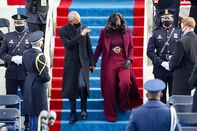 WASHINGTON, DC - JANUARY 20:  Former U.S. President Barack Obama and Michelle Obama at the inauguration of U.S. President-elect Joe Biden on the West Front of the U.S. Capitol on January 20, 2021 in Washington, DC.  During today's inauguration ceremony Joe Biden becomes the 46th president of the United States. (Photo by Rob Carr/Getty Images) Photo: Rob Carr, Getty Images