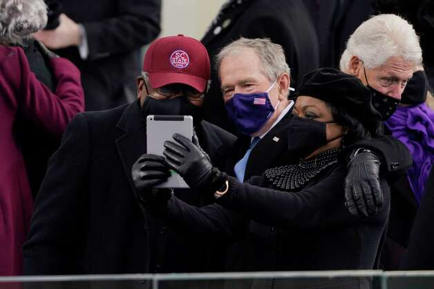 House Majority Whip James Clyburn of South Carolina, and former President George Bush, take a selfie before the 59th Presidential Inauguration at the U.S. Capitol in Washington, Wednesday, Jan. 20, 2021. Photo: Patrick Semansky, AP / Copyright 2021 The Associated Press. All rights reserved.