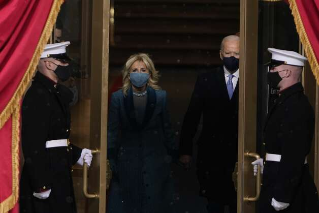 President-elect Joe Biden and his wife Jill, walk out for the 59th Presidential Inauguration at the U.S. Capitol in Washington, Wednesday, Jan. 20, 2021. Photo: Patrick Semansky/AP / Copyright 2021 The Associated Press. All rights reserved.
