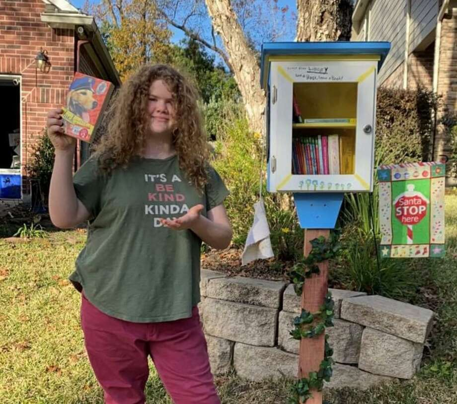 Ruth Schoppe, 12, is pictured with the little library she put together and painted for her Graystone Hills neighborhood. Photo: Courtesy Photo