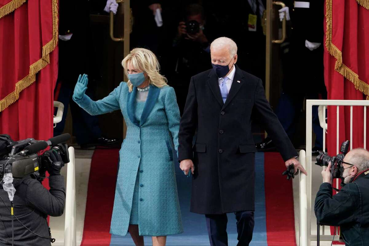 President-elect Joe Biden and his wife Jill, walk out for the 59th Presidential Inauguration at the U.S. Capitol in Washington, Wednesday, Jan. 20, 2021.
