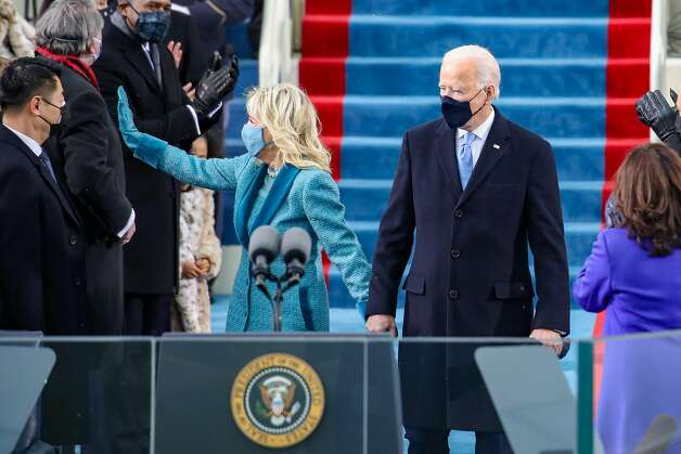 WASHINGTON, DC - JANUARY 20: U.S. President-elect Joe Biden and Jill Biden arrive at his Biden's inauguration on the West Front of the U.S. Capitol on January 20, 2021 in Washington, DC.  During today's inauguration ceremony Joe Biden becomes the 46th president of the United States. (Photo by Rob Carr/Getty Images) Photo: Rob Carr / Getty Images